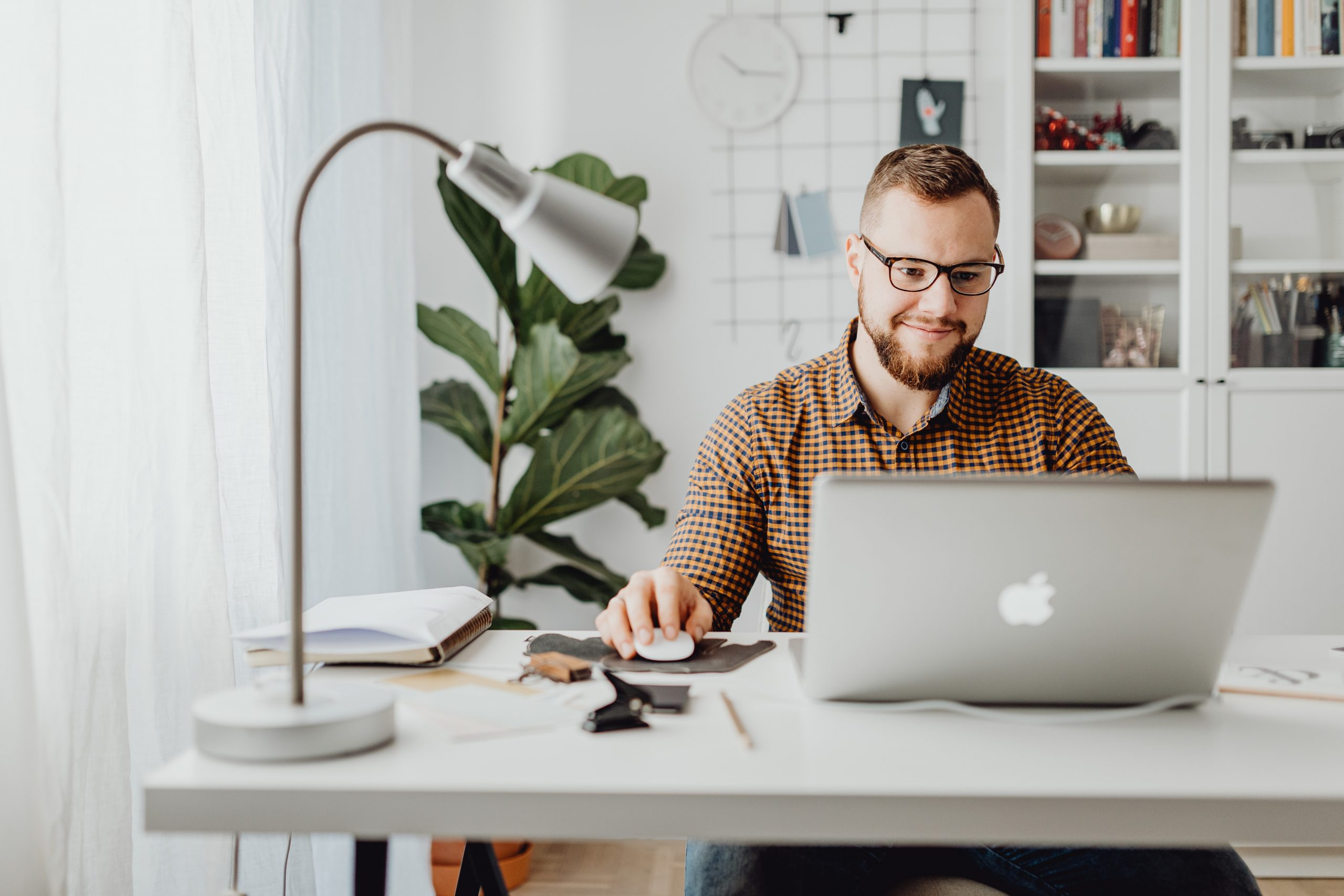 guy sitting at computer with glasses
